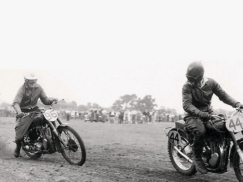 Five-times Australian Motocross Champion George Bailey leads John Burrows in a scramble during the 1950s